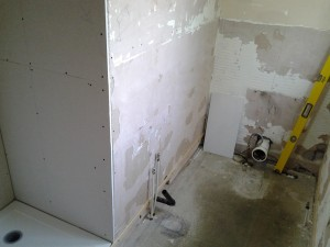 Before wall was tiled & plumbing ready for new toilet.